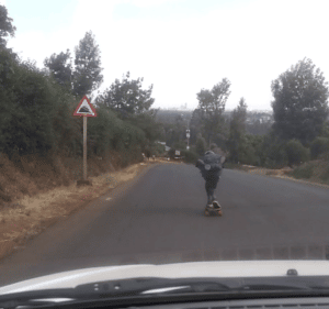 steep road sign + skater