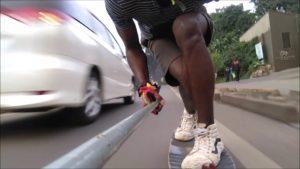 dangerous downhill skateboarding car
